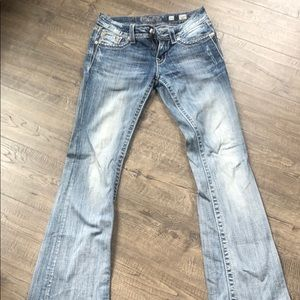 Cute light wash boot cut jeans.
